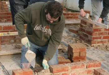 Students practicing brick work as part of their landscape construction module