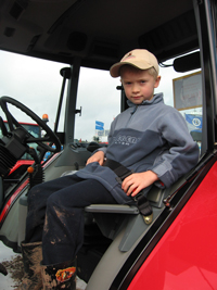 Child in tractor with seat belt